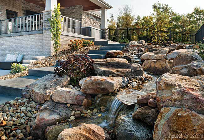 Waterfall leads to a fire pit