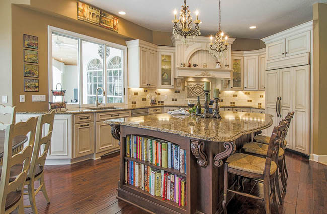 Kitchen island provides counter space and shelving