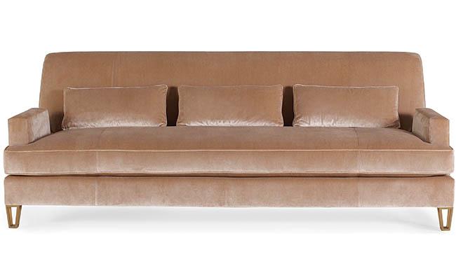Velvet sofa with unique front leg finish