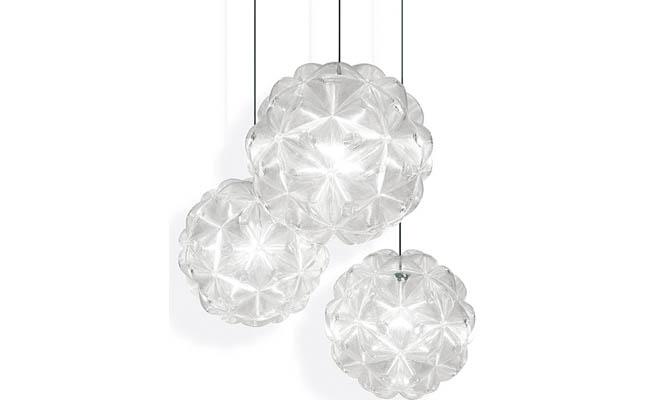 Spherical pendant light dazzles guests