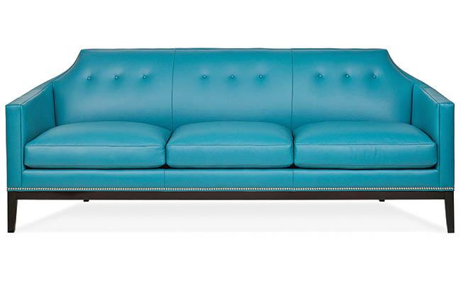 Blue sofa with nailhead trim