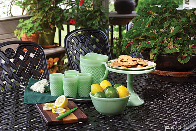 Green glass atop an outdoor dining table
