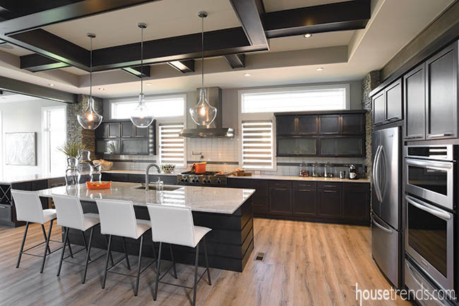 Dark maple cabinets contrast with flooring