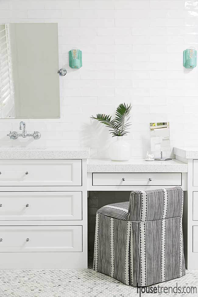 Turquoise lights take the spotlight in a white master bath