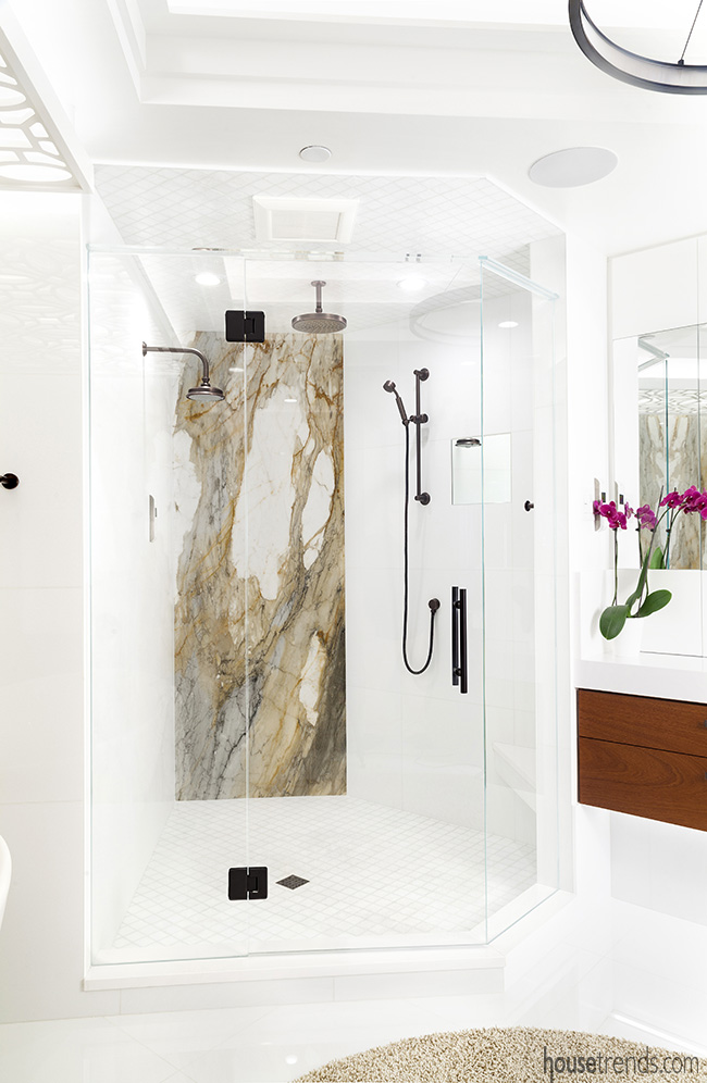 Dark bronze plumbing fixtures add character to the shower in this bathroom remodel