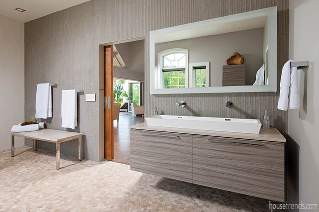 Floating vanity adds a modern touch to a pool house bath
