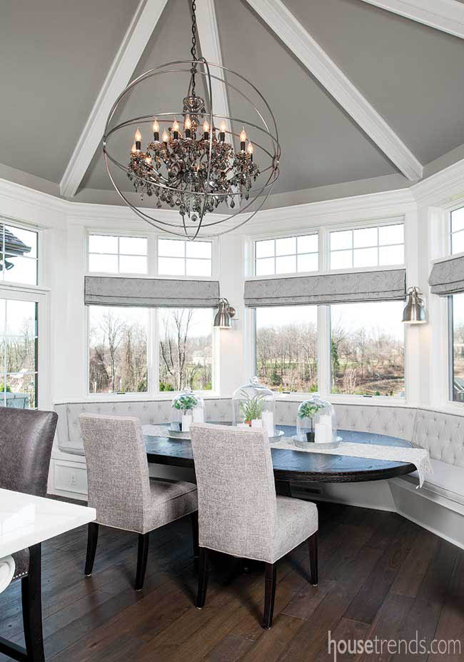 Windows lend natural light to an eating area