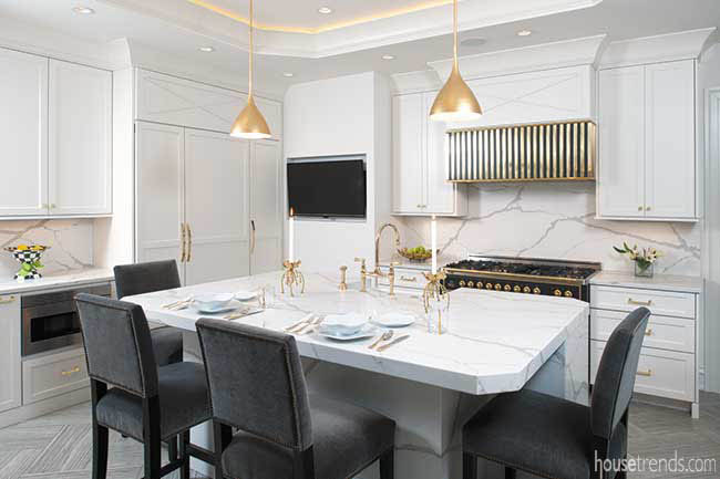 Gold pendant lights pop in a kitchen