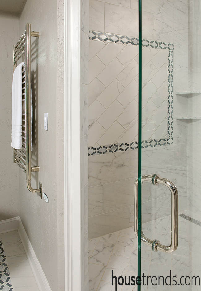 Glass shower door offers a glimpse of tile