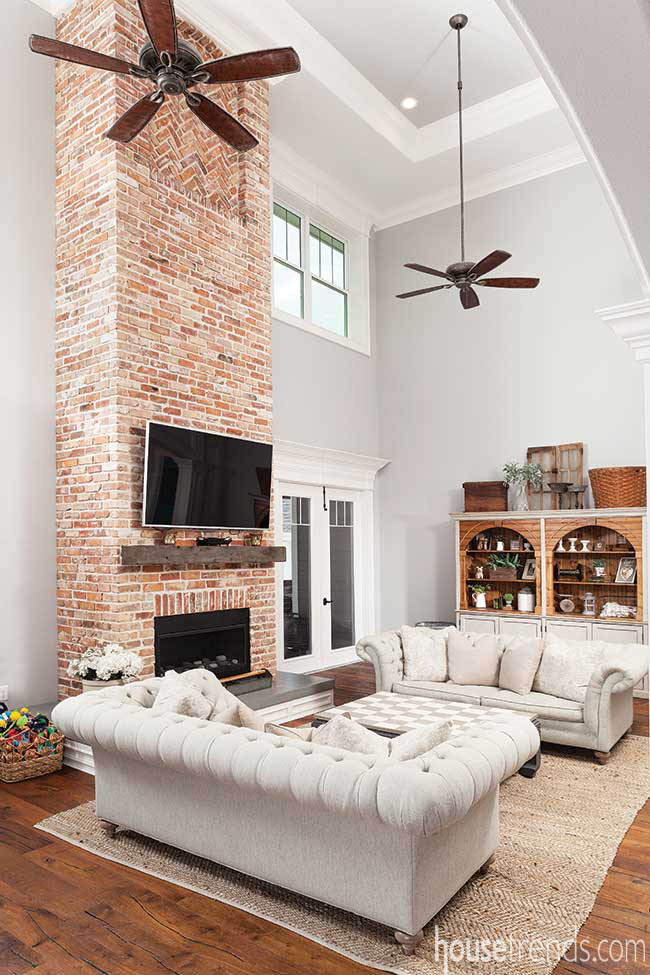 Brick fireplace surround stretches to the ceiling