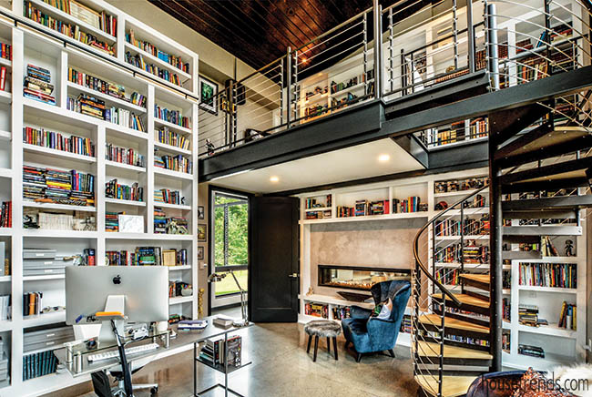 Two-sided fireplace warms up a library