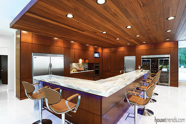 Cherry cabinets blend with a ceiling treatment