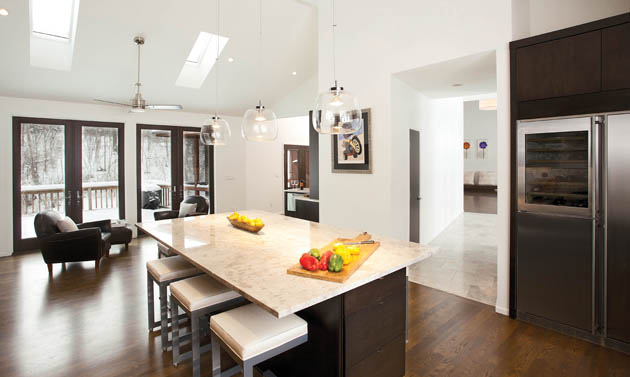 An island topped with a granite countertop provides the perfect place for party prepping