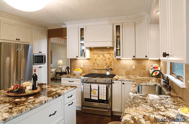 Granite countertops complement cabinet hardware
