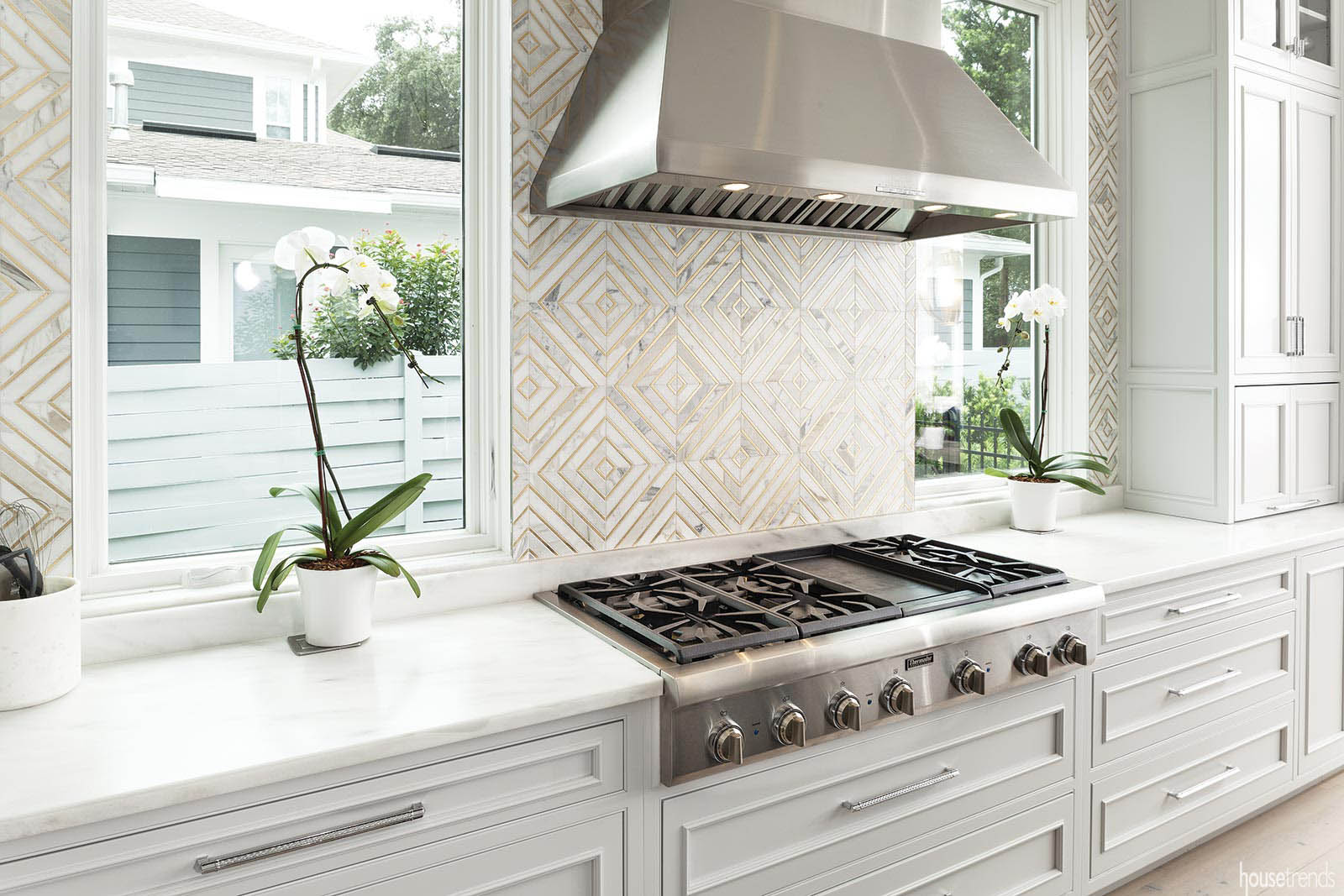 Backsplash stretches to the ceiling
