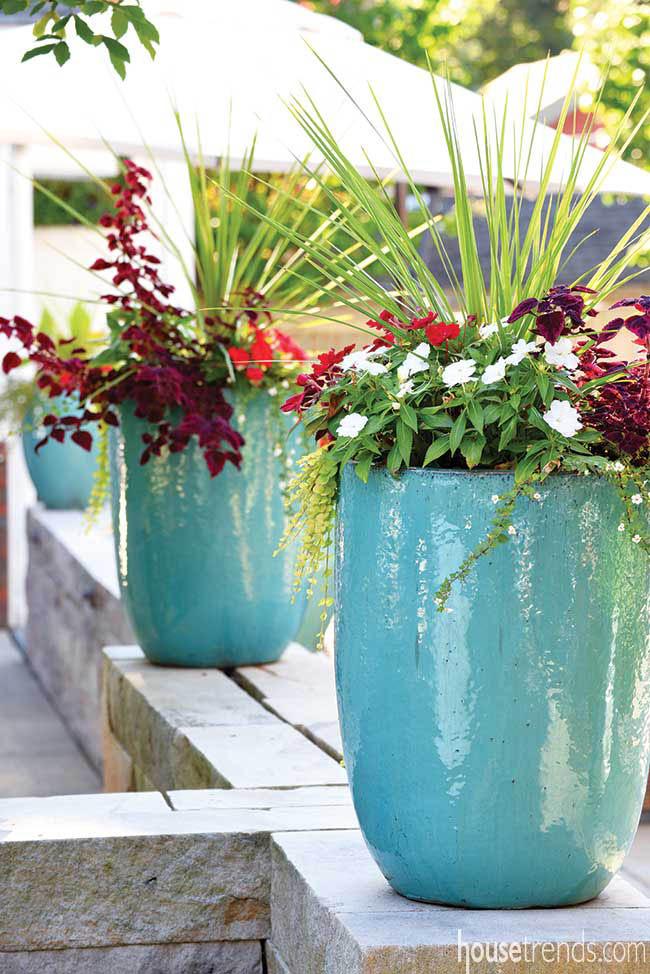 Flower pots color up a back yard