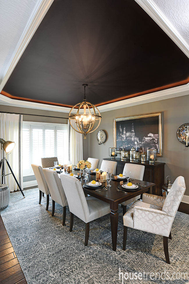 Orbit light fixture shines in a formal dining room