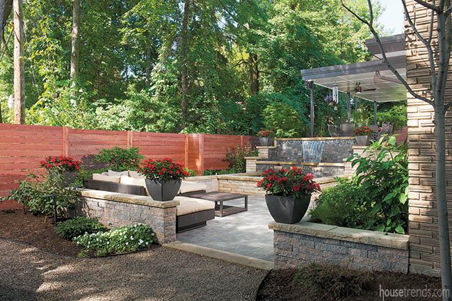 Unilock pavers cover a back yard patio