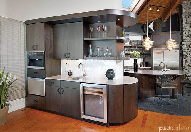 Sleek cabinetry complements a wet bar