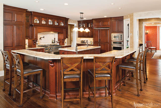 Gourmet kitchen features gorgeous cabinetry and a prep island