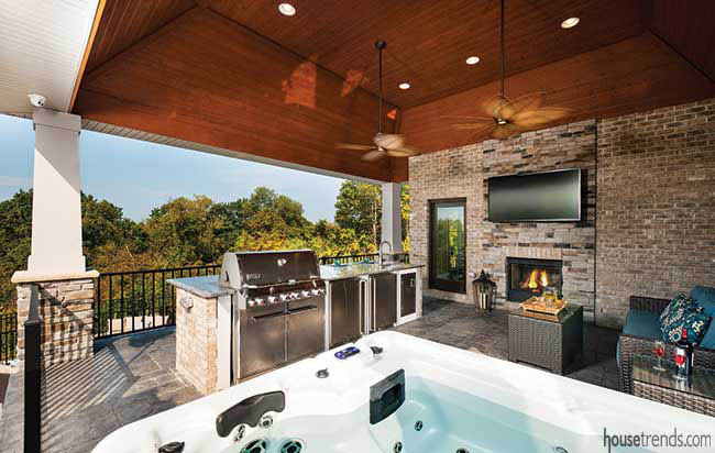 Outdoor living srea with a variety of amenities