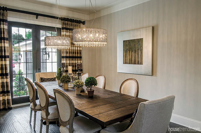 Dining room curtains help to soften this inviting eating space