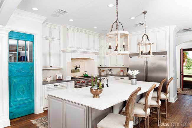 Teal door draws the eye in a white kitchen