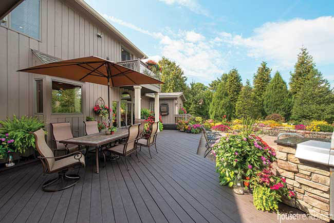 Outdoor dining area surrounded by blooming flowers