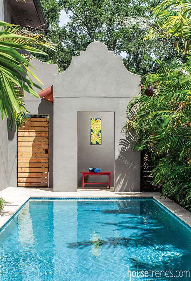 Tile work adorns the open-air space at the pool