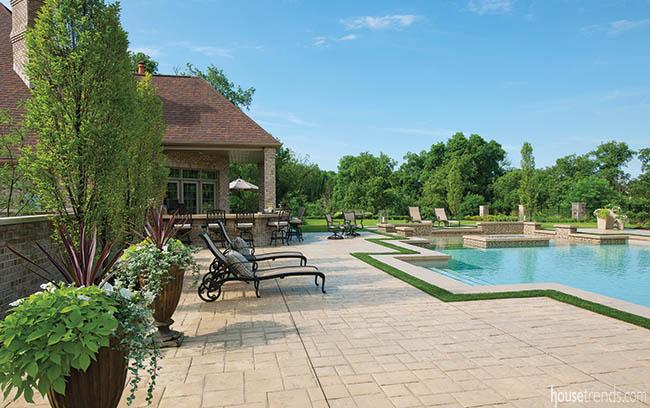 Pool deck mimics an English garden design