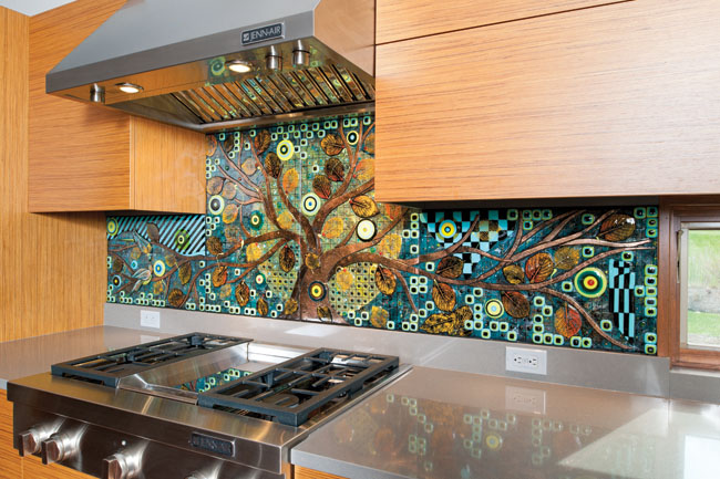 Glass backsplash design reflects the outdoors