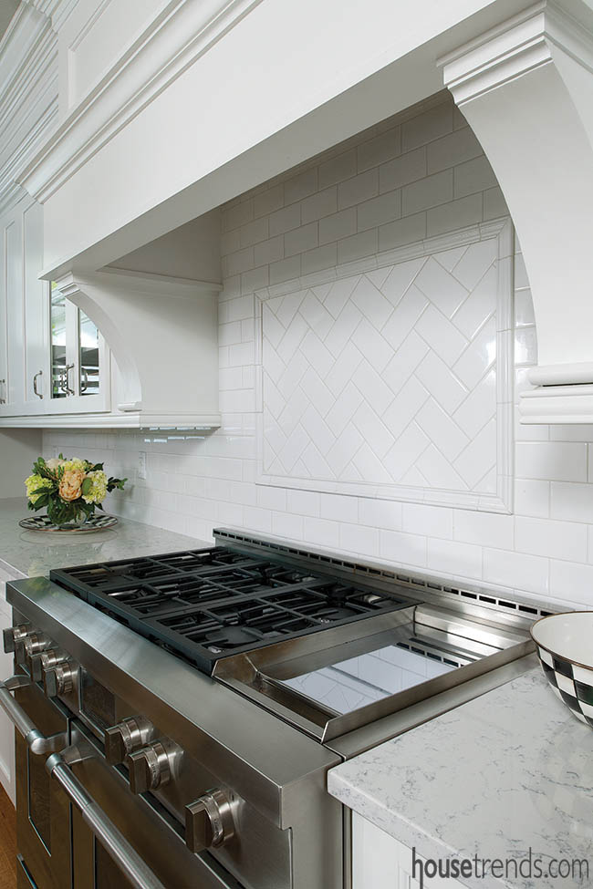 Subway tile backsplash in a herringbone pattern
