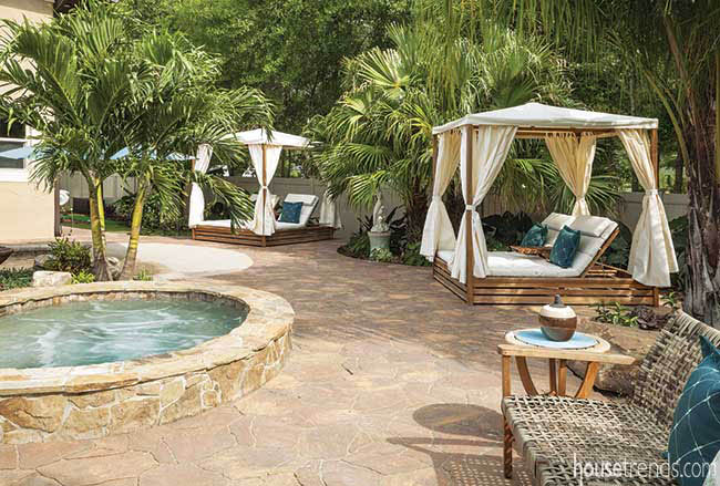Cabanas offer shade around a swimming pool