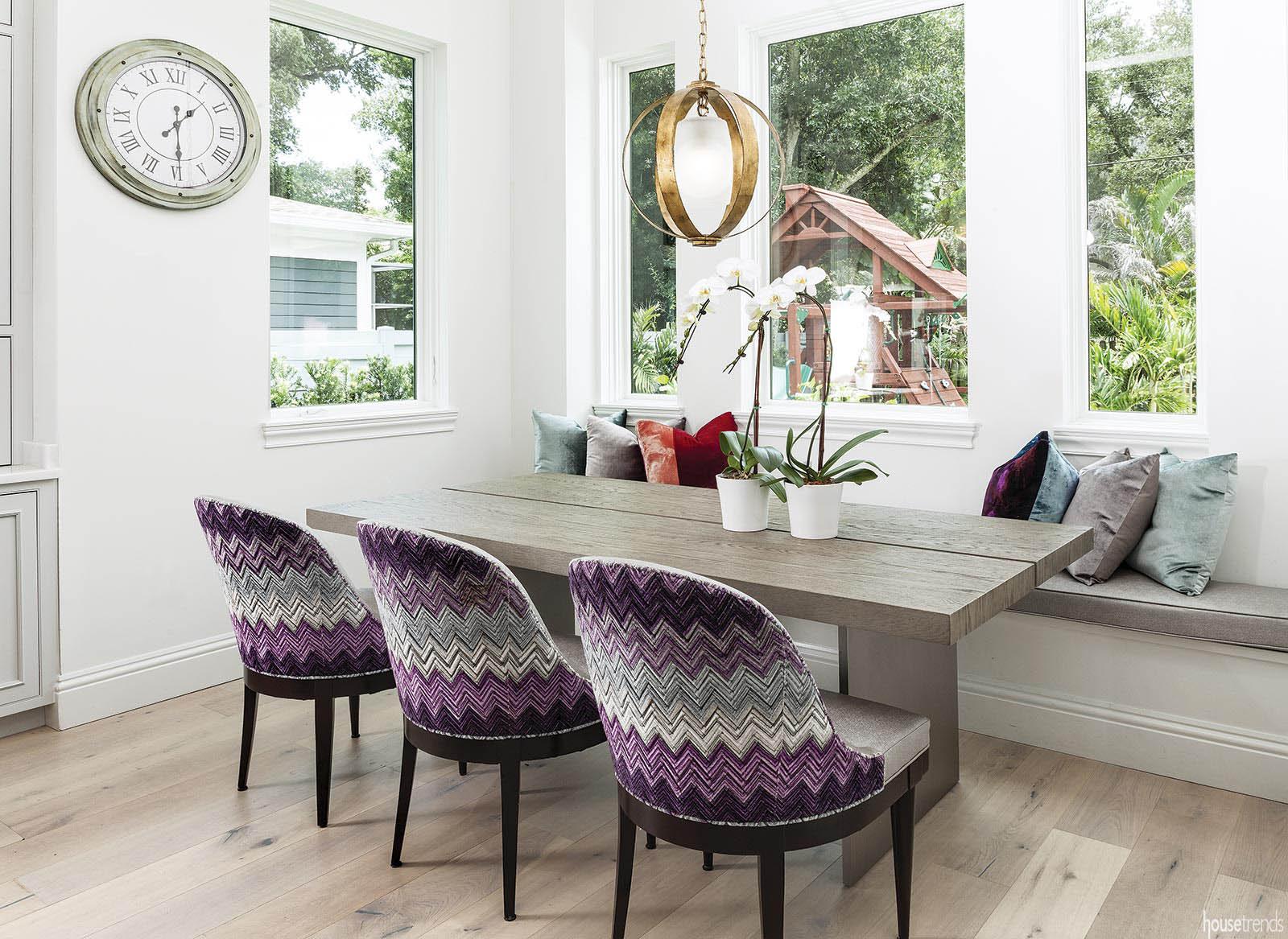 Purple chairs pop in a breakfast nook