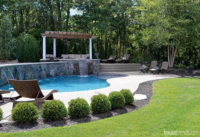Cedar pergola overlooks a swimming pool