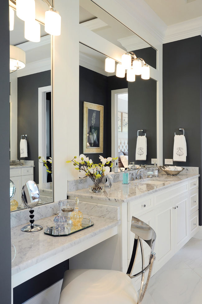 Bathroom mirrors highlight the ceiling's soaring height
