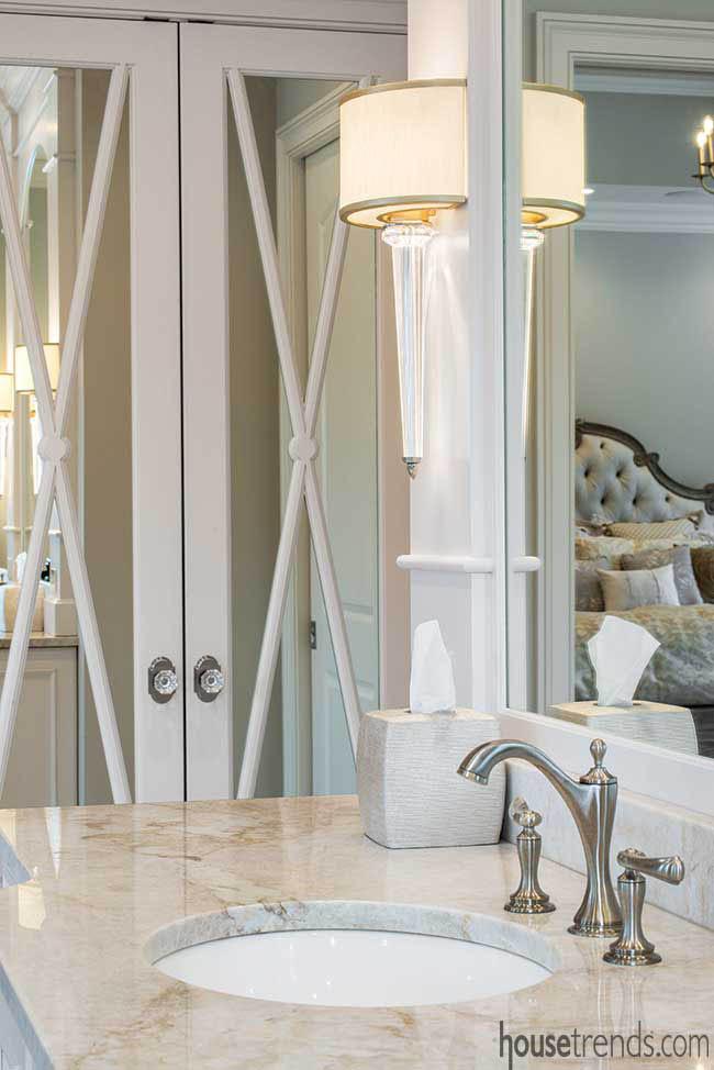 Mirrored doors hide a linen closet
