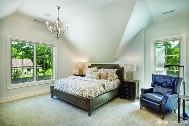 Master bedroom is built into the corner of a second level addition.