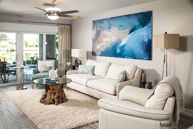 Blue wall art pops in a living room