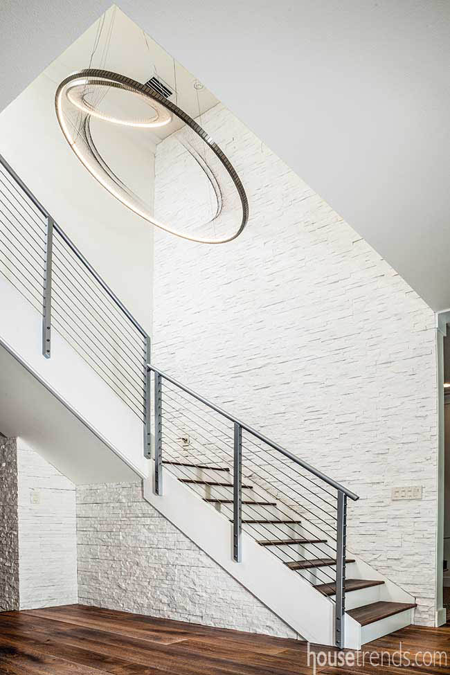 Pendant lights add drama to a staircase