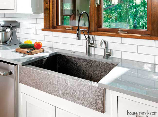 Kitchen remodel features nickel farmhouse sink