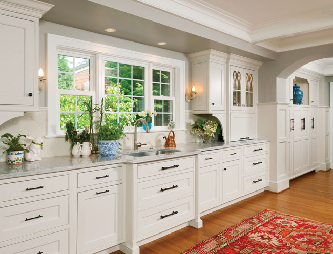 Painted kitchen cabinets complement the granite countertops