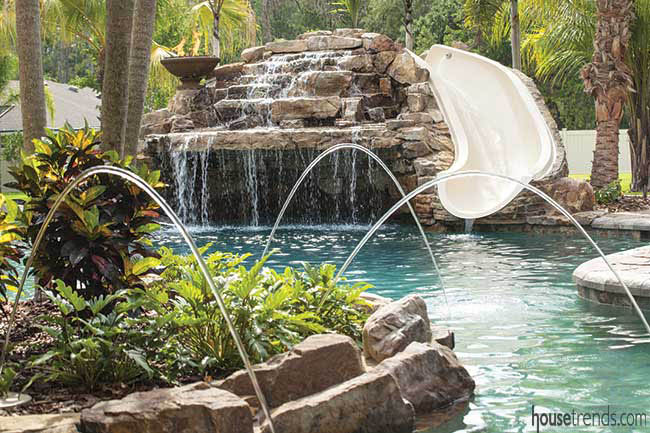 Waterfall spills into a swimming pool
