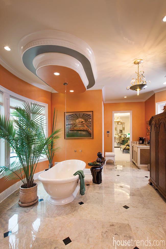 Bathtub stands alone in modern bathroom
