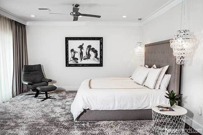 Master suite with access to a balcony
