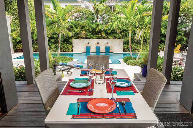 Outdoor dining area overlooks pool and patio