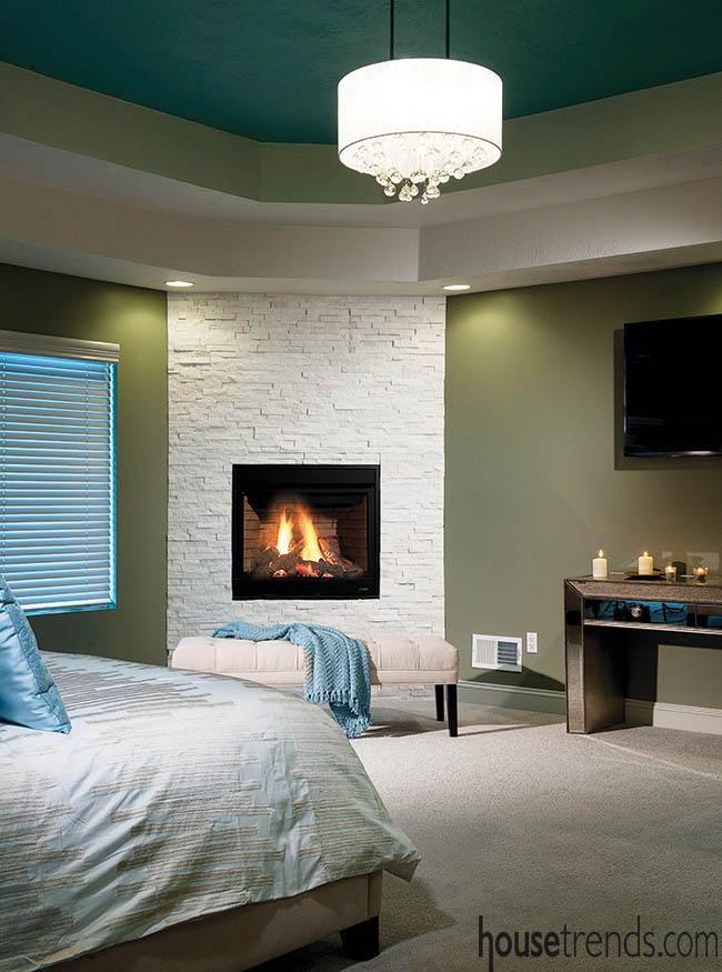 Light fixture and fireplace create an elegant design