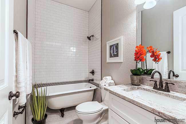 Subway tile frames a clawfoot tub