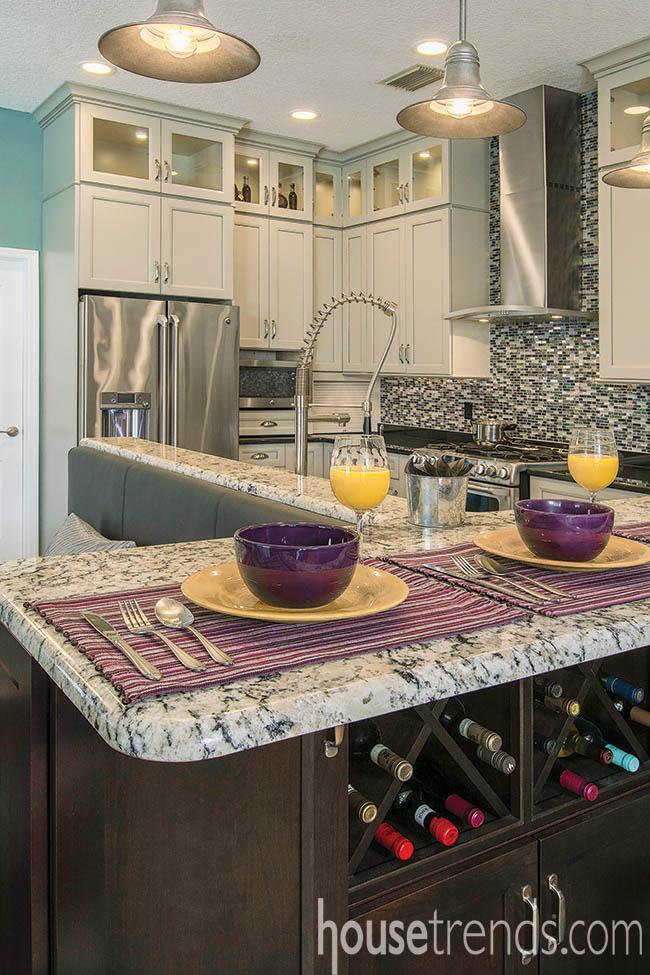 Kitchen island tucks away a home wine bar