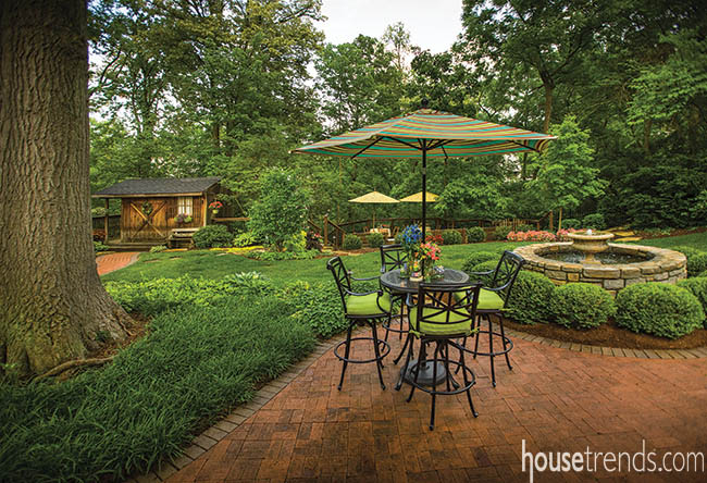 Table and outdoor bar stools create intimate seating area